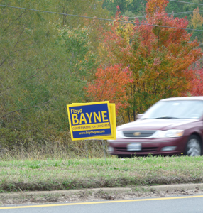 Floyd Bayne sign set in median strip is not allowed